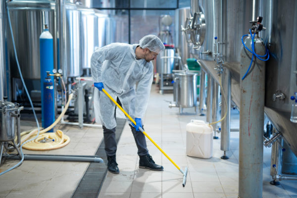photo of a TFC commercial cleaning technician cleaning floors in a cGMP regulated facility