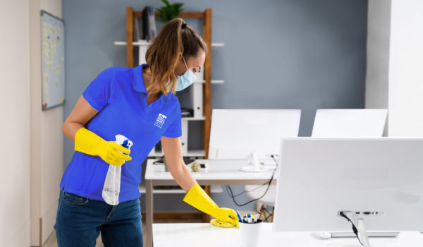 photo of female technician providing commercial cleaning services in an office