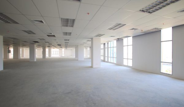 photo showing an empty office room after receiving post-construction cleaning services